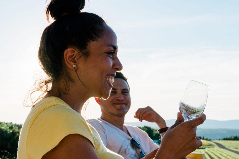smilling girl drinking wine