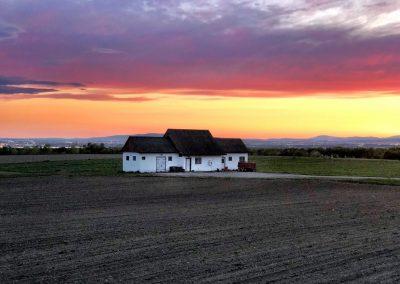 sunset ile d'orléans with white farm
